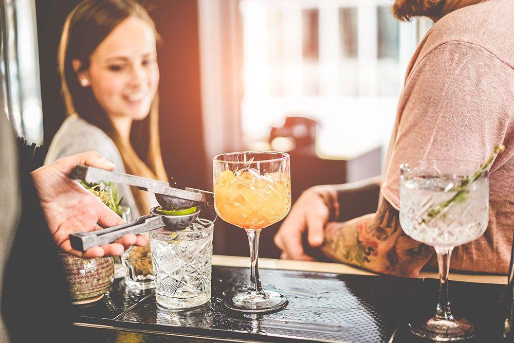 girl smiling at a bar